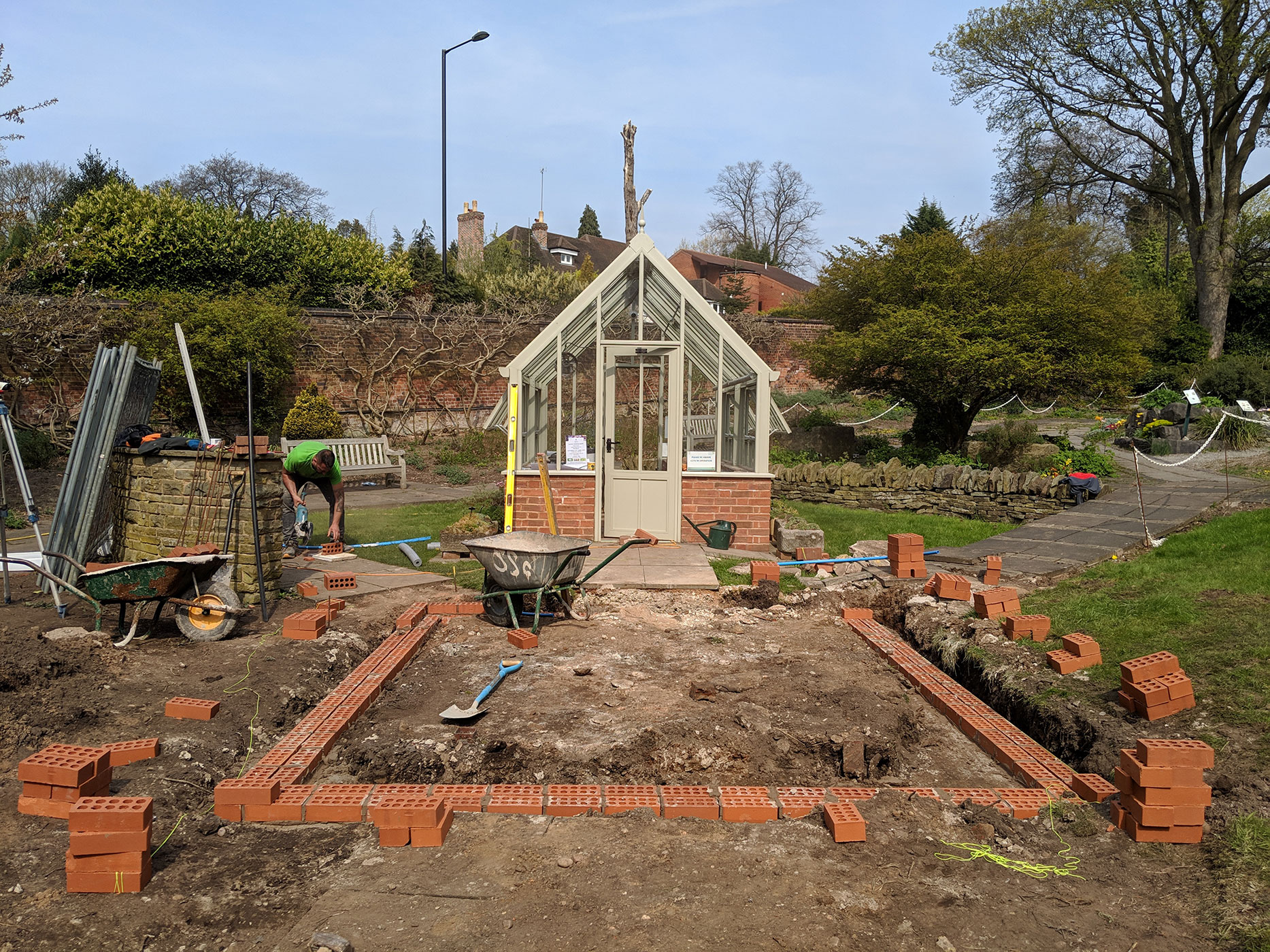 The brick work started and allignement with the existing glasshouse carefully sought after.