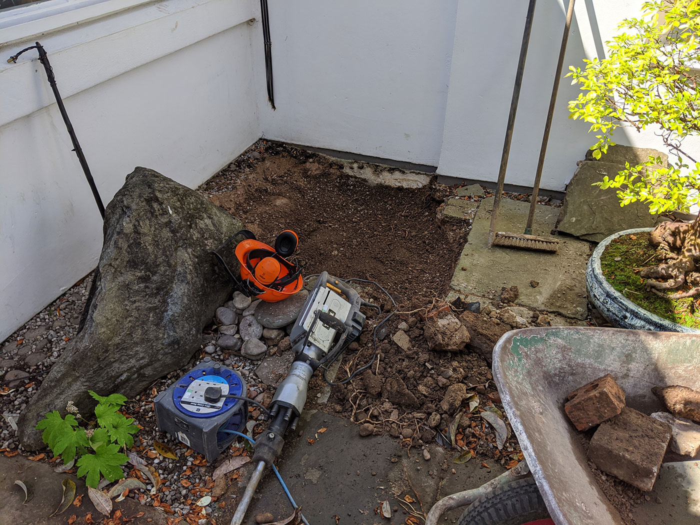 A new ericaceous beds: slabs are taken out and soil improved