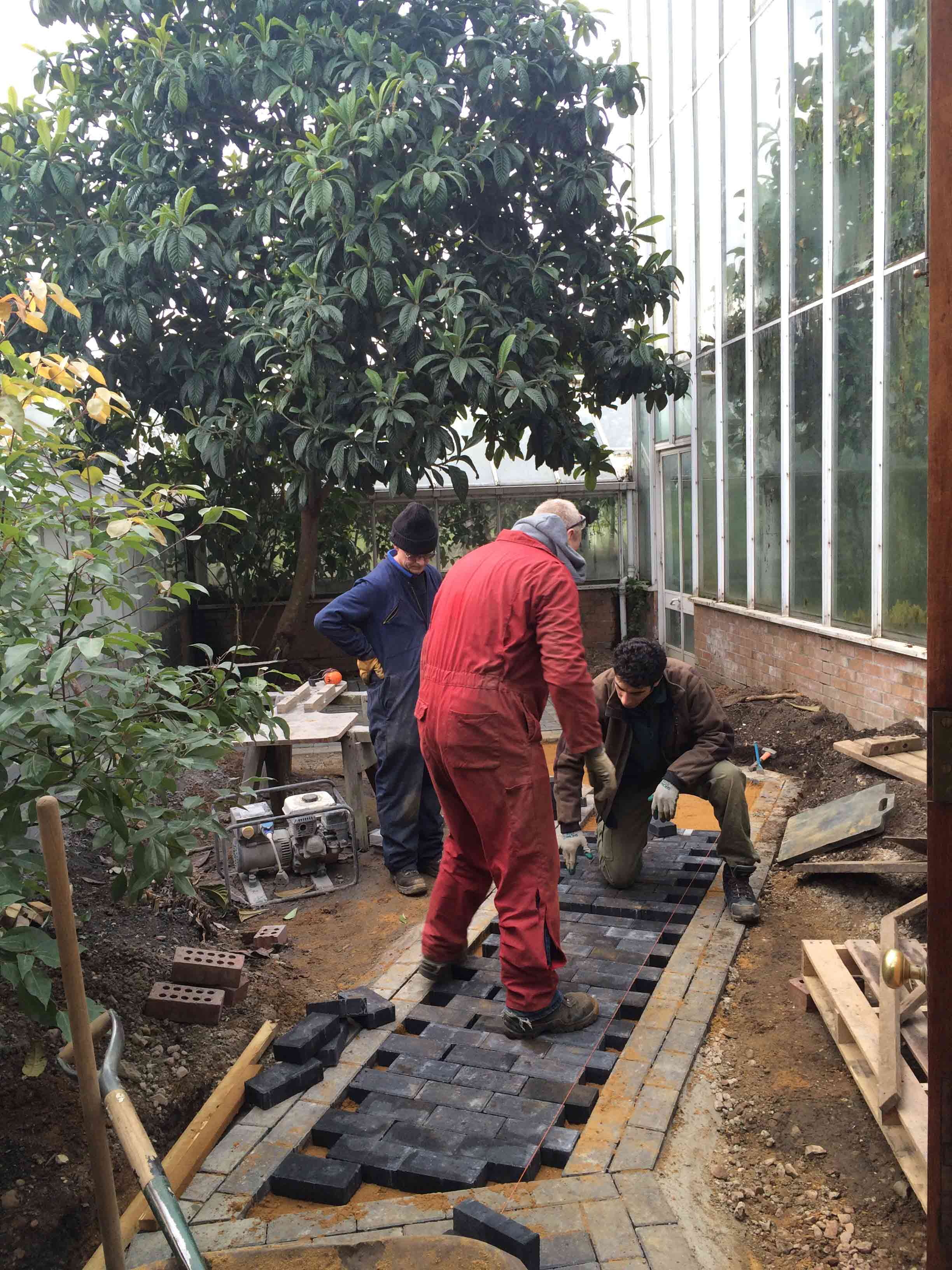 Paving work by the glasshouse courtyard, with the Landscape and Machinery Team
